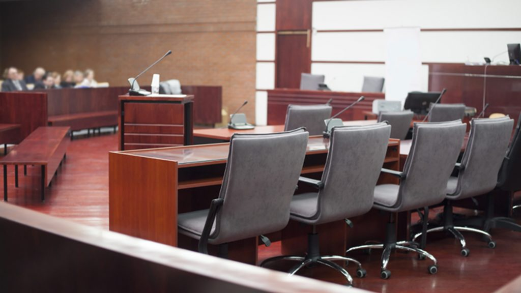 Defendants' table in courtroom